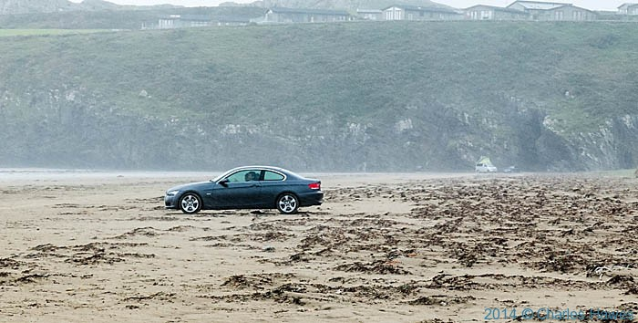 car parked on beach at Black Rock Sands on the Lleyn peninsula, photographed from The Wales Coast Path by Charles Hawes