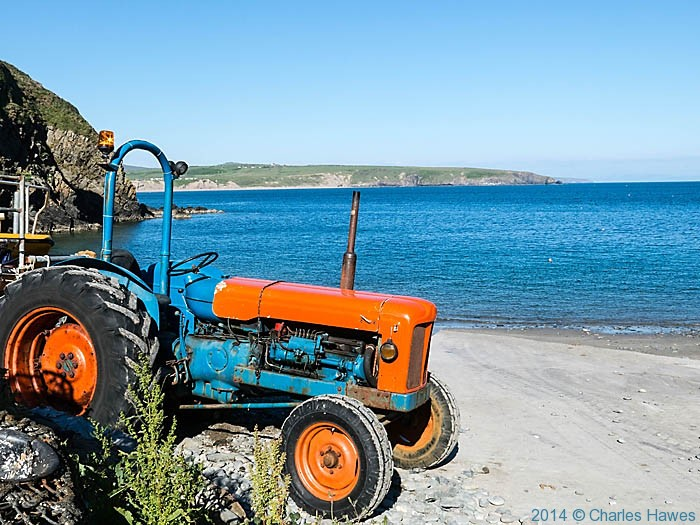 Tractor on Porth Meudwy, photographed from The Wales Coast Path by Charles Hawes