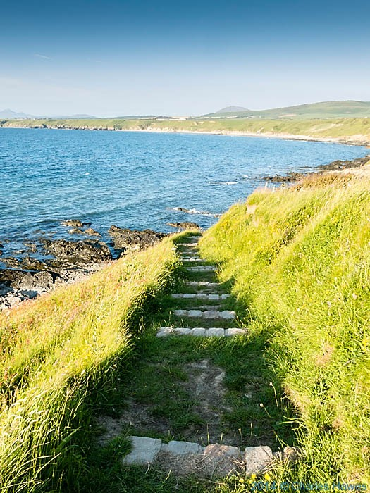 Steps down to Porth Colmon, photographed from The Wales Coast Path by Charles Hawes