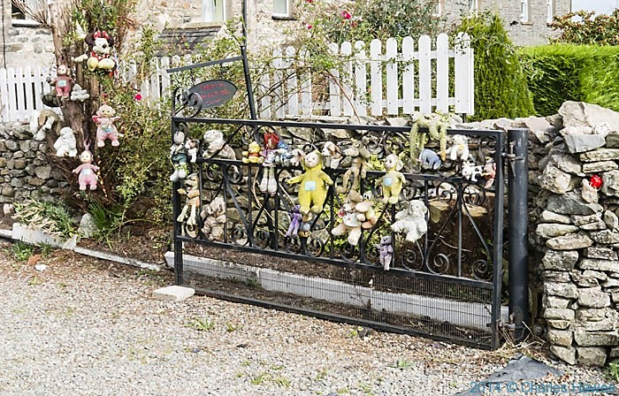Gate of kitsch  house in Milltrop, Cumbria, photographed by Charles Hawes