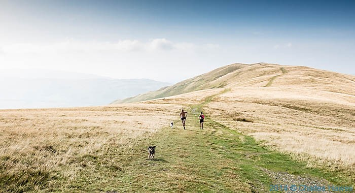 Runners on the approach to Calders on the Howgill Fells, Cumbria, photographed by Charles Hawes