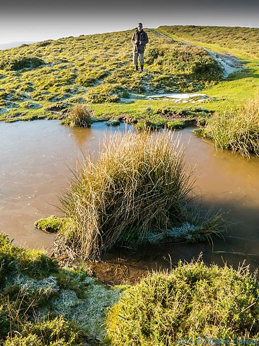 Paul Steer by frozen pond on Sugar Loaf, Abergavenny, Monmouthshire, photographed by Charles Hawes