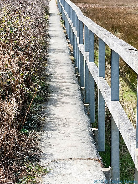 Wales Coast Path taking the seawall by red Wharf bay, Anglesey, photographed by Charles Hawes