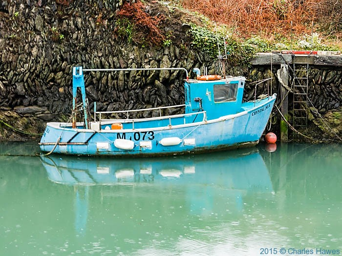 Fishing boat in amlwch Harbour, photographed from The Wales Coast Path by Charles Hawes