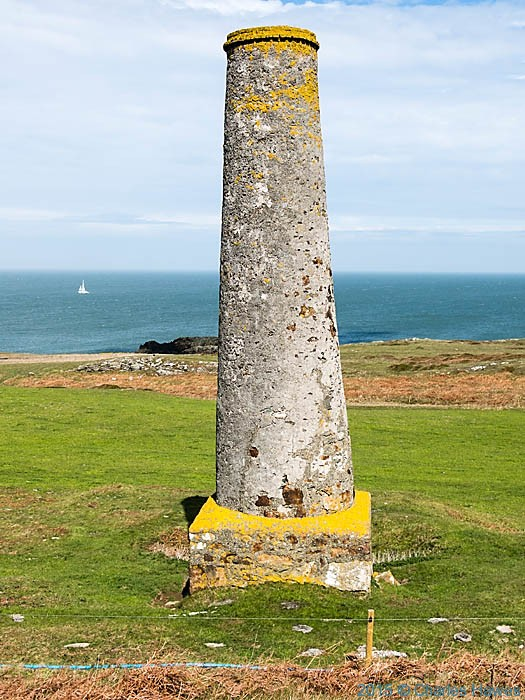 Chimney of an old copper mine on Carmel Head, Anglesey, photographed from The Wales Coast Path by Charles Hawes
