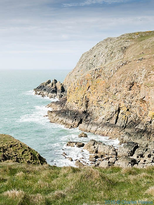 Coast near Carmel Head photographed from The Wales Coast Path by Charles Hawes