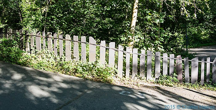 Slate fence near Bangor, photographed from The Wales Coast Path by Charles Hawes
