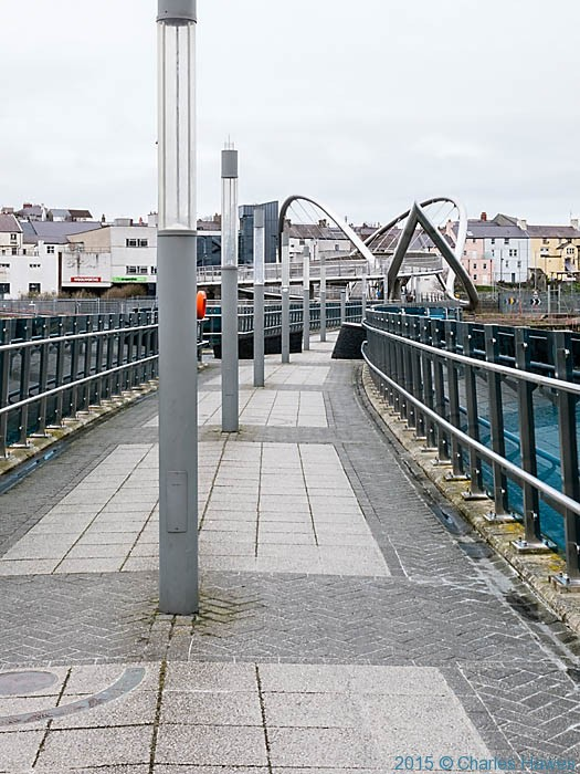 Bridge connecting the ferry terminal to the town, Holyhead, photographed from the Wales Coast Path by Charles Hawes