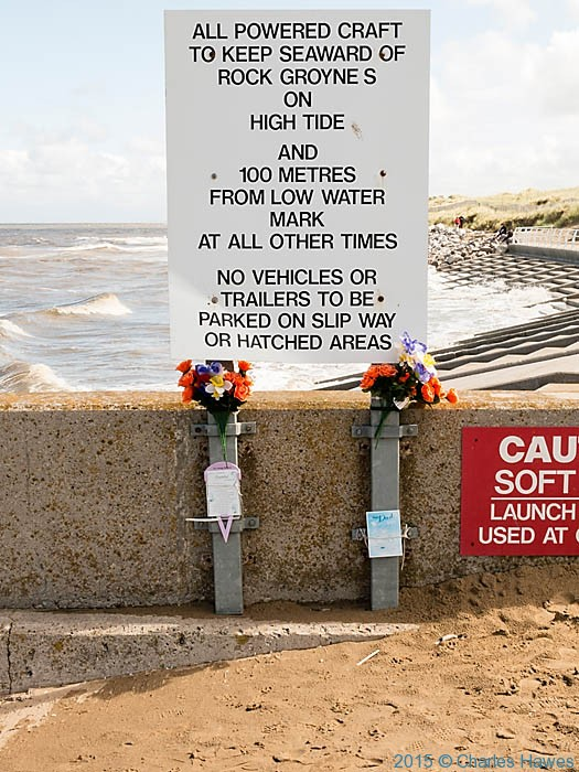 Warning sign at the breakwater near Prestatyn, photographed from The Wales Coast Path by Charles Hawes