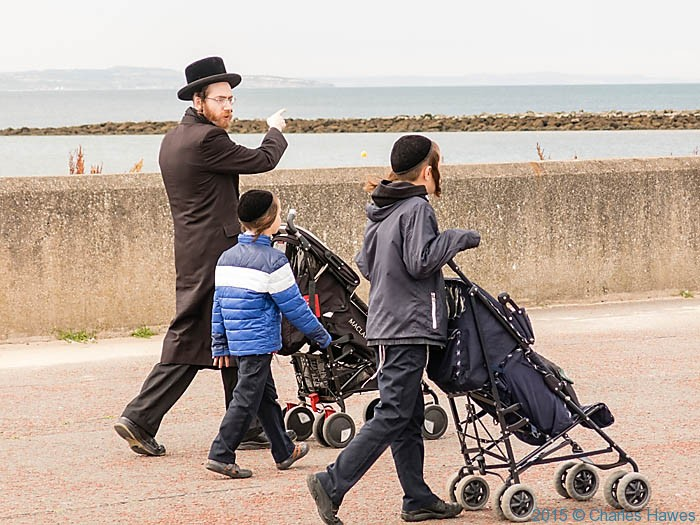 Hassidic family on the sea front near Llandudno, photographed by Charles Hawes