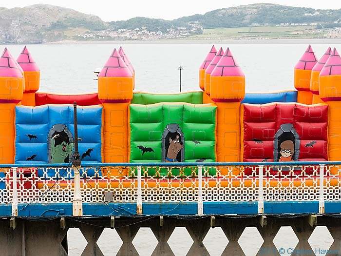 Bouncy Castle on Llandudno Pier, photographed from The Wales Coast Path by Charles Hawes