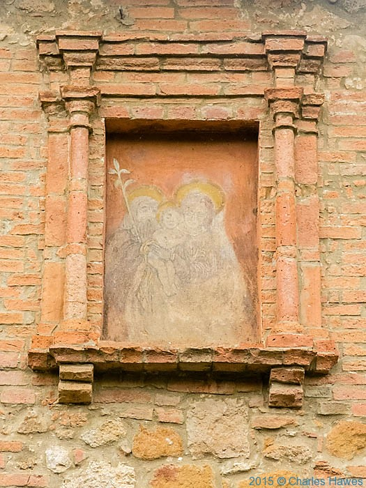 Madonna fresco on house outside Pienza, photographed by Charles Hawes