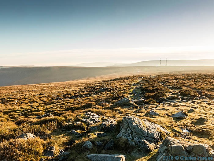 View to the twin masts of WT station at Cefn y Galchen, photographed from The Cambrian Way near Blorenge by Charles Hawes