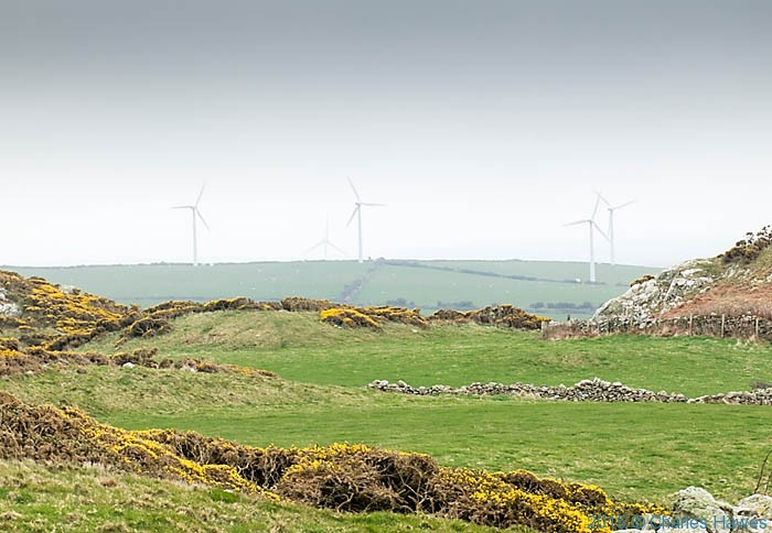 Wind turbines near Porth llanlleiana photographed from the Wales Coast Path in Anglesey by Charles Hawes
