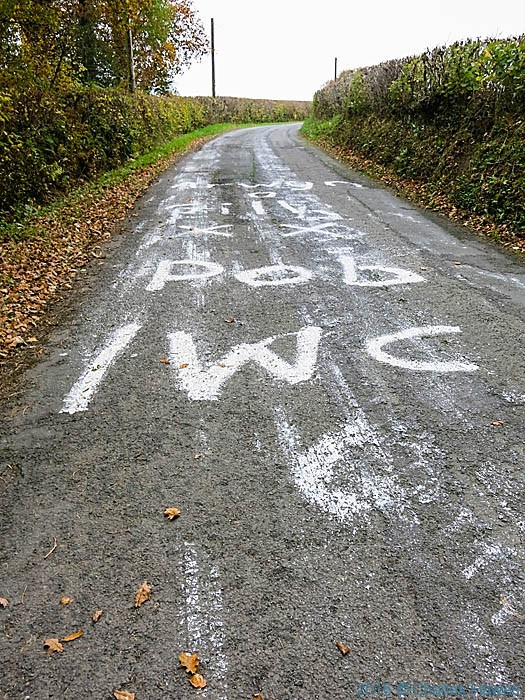 Writing in welsh on the road near Myddfai, photographed from The Cambrian Way by Charles Hawes