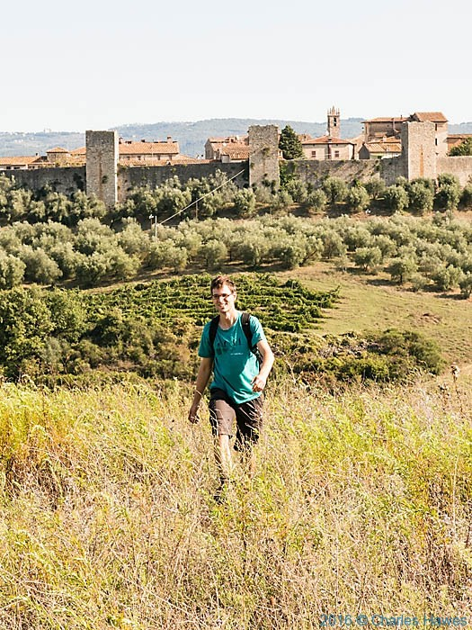 Toon Verlinden in front of view to Monteriggioni, photographed from the Via Francigena by Charles Hawes