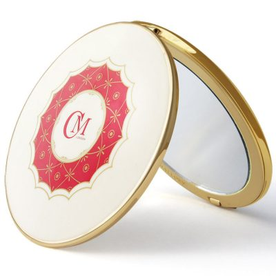 Gold enameled magnified mirror compact