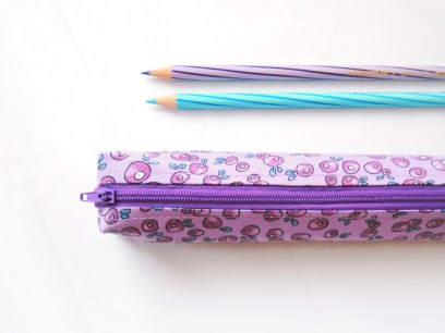 Small pencil case in purple with purple berries and blue leaves