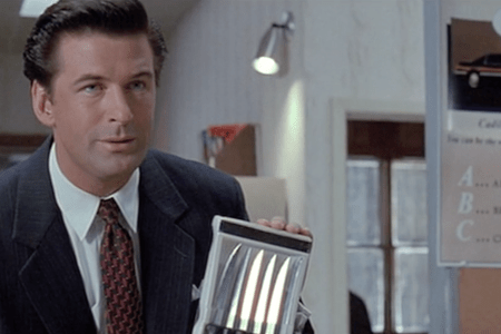 Picture of Alec Baldwin holding up steak knives in Glengarry Glen Ross