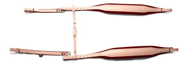 White accordion straps on red velvet