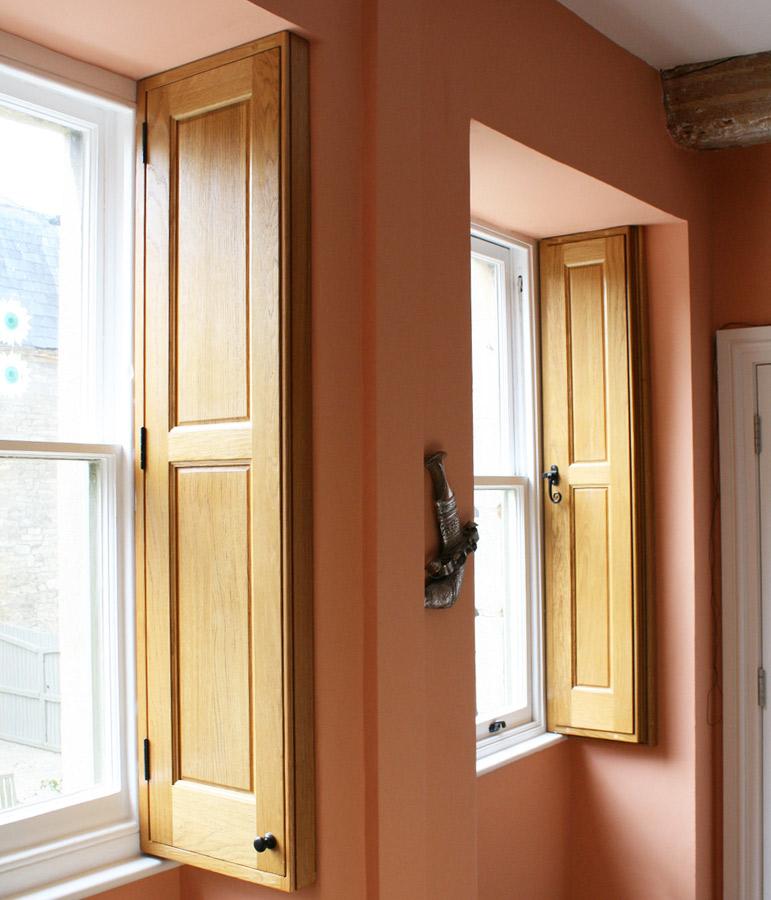 charlie-caffyn-designs-oak-shutters-that-foldaway-into-oak-cabinets
