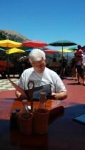 Dennis studies the menu