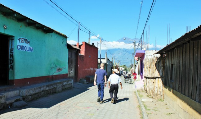 Luke walking with Guatemalan farmer before cooking class - charlie on travel 1000