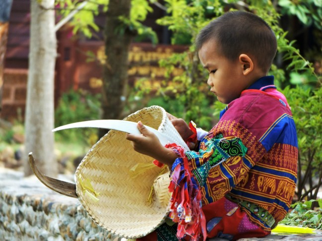 Little Boy and his Mask at Phi Ta Khon Festival Thailand - Loei - Charlie on Travel