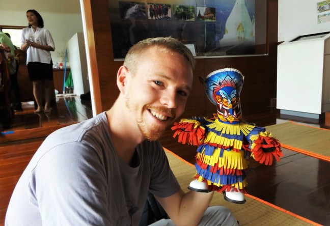 Luke and a puppet at Phi Ta Khon Festival Thailand - Loei - Charlie on Travel