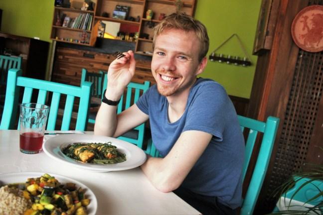 Luke in a vegan restaurant in Tulum Mexico - Charlie on Travel