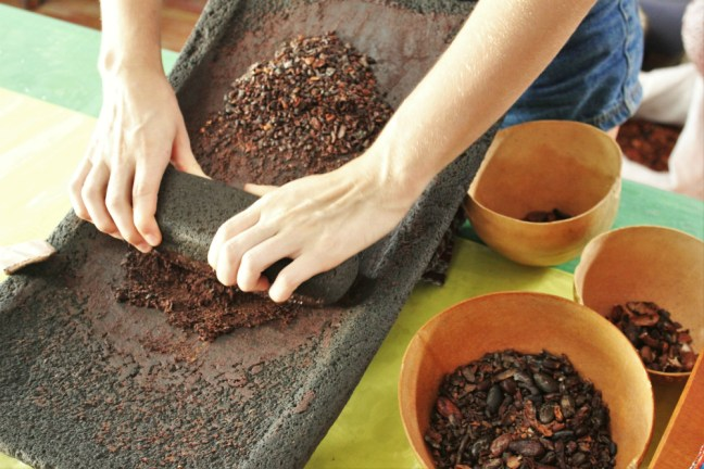 Charlie making cacao paste at AJAW Chocolate San Ignacio Belize - Charlie on Travel