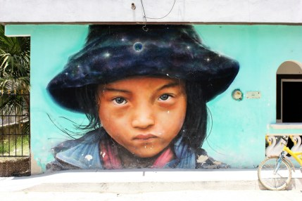Girl street mural - Isla Holbox Mexico - Charlie on Travel