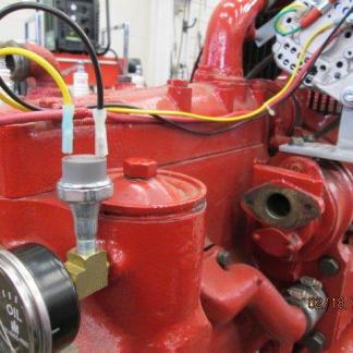 Magneto oil pressure switch