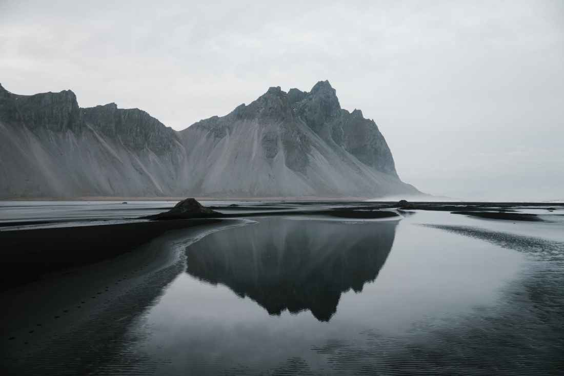 peaceful cliffs across lake in cloudy day