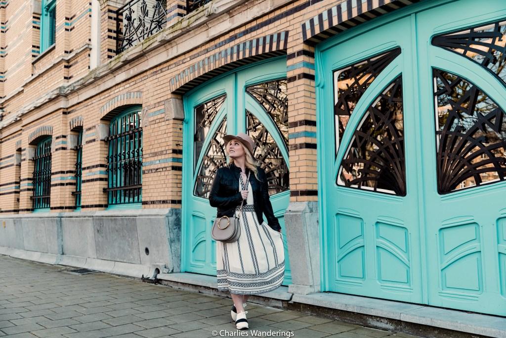 girl standing in front of turquoise door