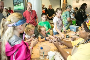 making pottery with Clayworks at 2016 Charlotte Mini Maker Faire
