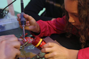 soldering at 2016 Charlotte Mini Maker Faire