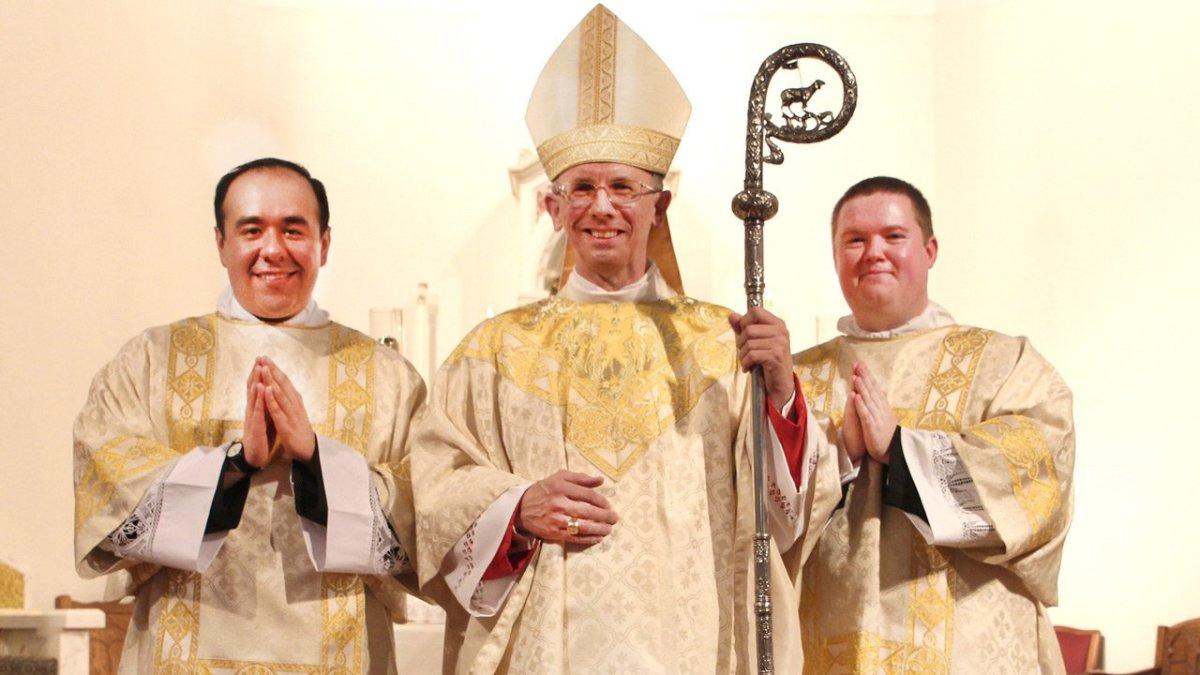 Bishop Jugis ordains two men to transitional diaconate