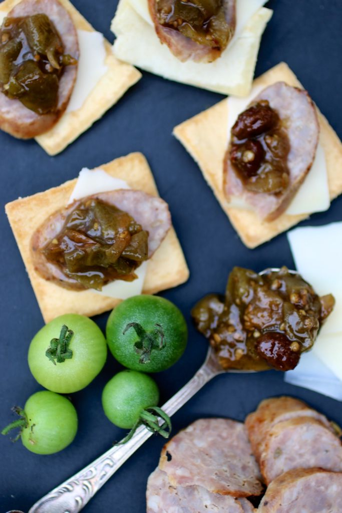 crackers with cheese sausage and tomato chutney