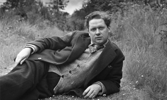 Dylan Thomas's writing shed b/w poet lying in grass