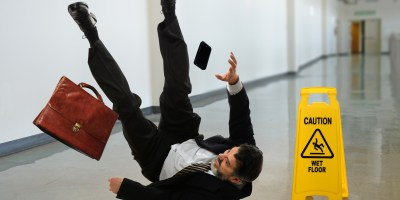 Man falling due to flip & fall hazards at his workplace