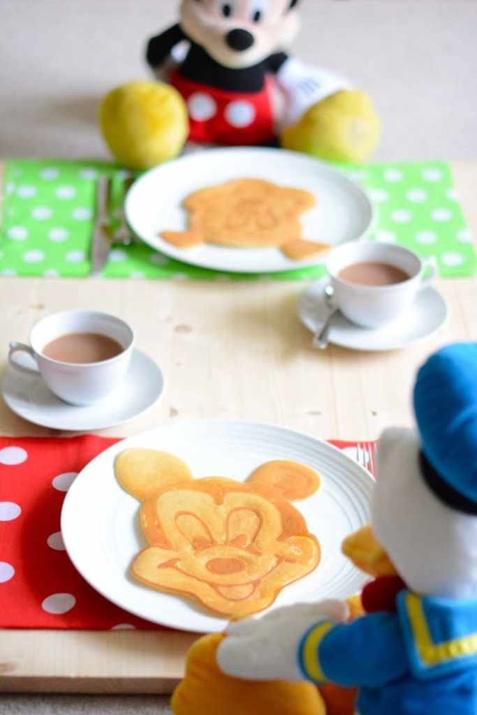 Mickey Mouse and Donald enjoying some mickey mouse pancake art for breakfast