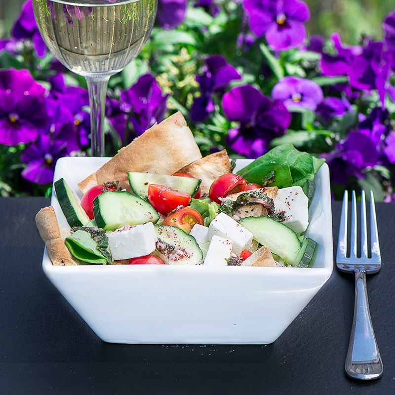 Fattoush Salad - A delicious summer salad with crispy pitta bread, feta cheese and a lemon, mint and sumac dressing.