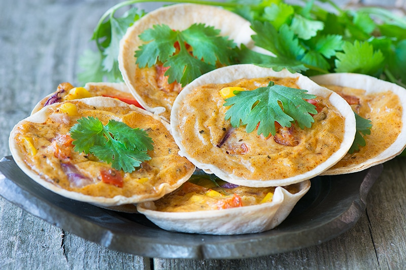 Circles of tortilla replace the pastry in these easy to make mini quiches flavoured with cajun spices, red pepper, red onion and sweetcorn