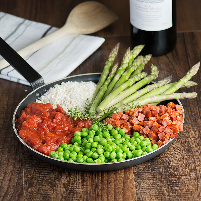 Baked chorizo and asparagus risotto - a delicious, rich risotto, quick and easy to make, and ready for the oven in under 10 minutes. Under 600 calories and 2 of your 5-a-day.