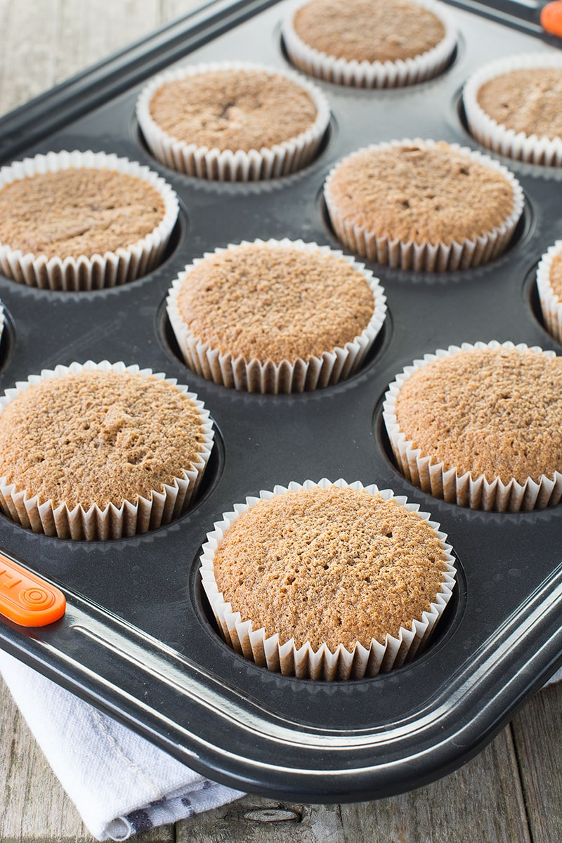 Freshly baked coffee cupcakes in a muffin tin.