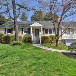 1435 Kenwood Lane is a charming home in Charlottesville with main level bedrooms, sunroom, fenced yard, elevator, close to Charlottesville High School.