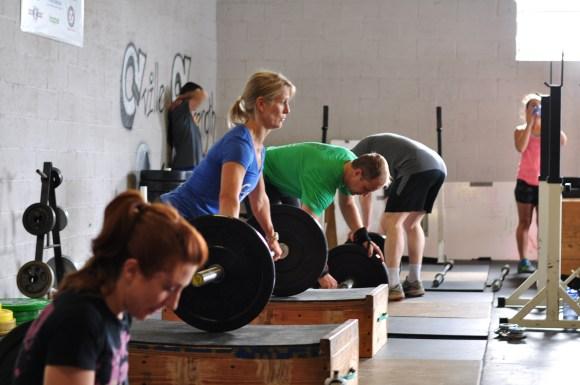 Doing weightlifting activities.
