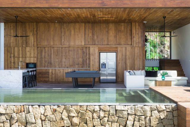 リビングルーム、キッチン、ダイニングエリアは、ほとんどの現代的な家のようなものにブレンドされています。