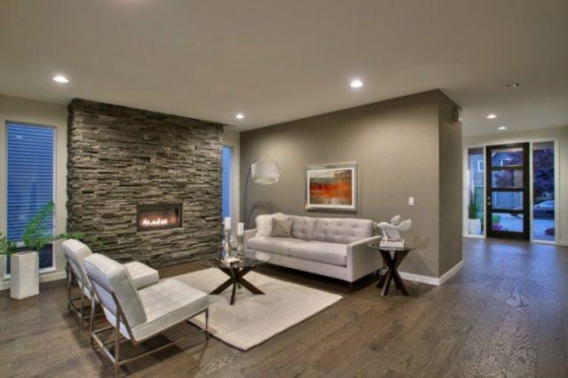 リビングルーム7で魅力的な積み重ねられた石造りの暖炉のデザインの暖かさを取得します。
